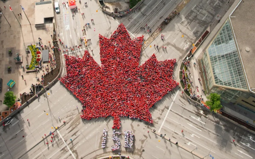 crowd gathered in a canadian flag design